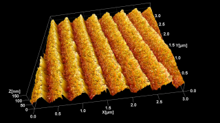 This is a topography image of a holographic, UV optimized, blazed diffraction grating with 2400 lines/mm. It is a good graphic illustration of how much further at the nanoscale Atomic Force Microscopy allows us to 'see' beyond what any optical device could. The ridges diffract visible and near-UV light. To light these ridges are perfectly flat. The AFM using a sharp BudgetSensors tip shows us that their surface is actually quite rough.